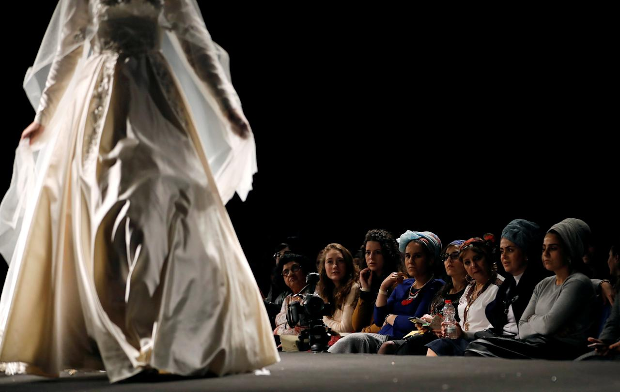 """A model walks down the runway during an event dubbed, """"Modest Fashion Day"""", the first of its kind in Israel, whereby designers showed off their clothing creations aimed at Orthodox Jewish women who adhere to strict dress codes, in Jerusalem February 23, 2017. REUTERS/Ronen Zvulun TPX IMAGES OF THE DAY"""