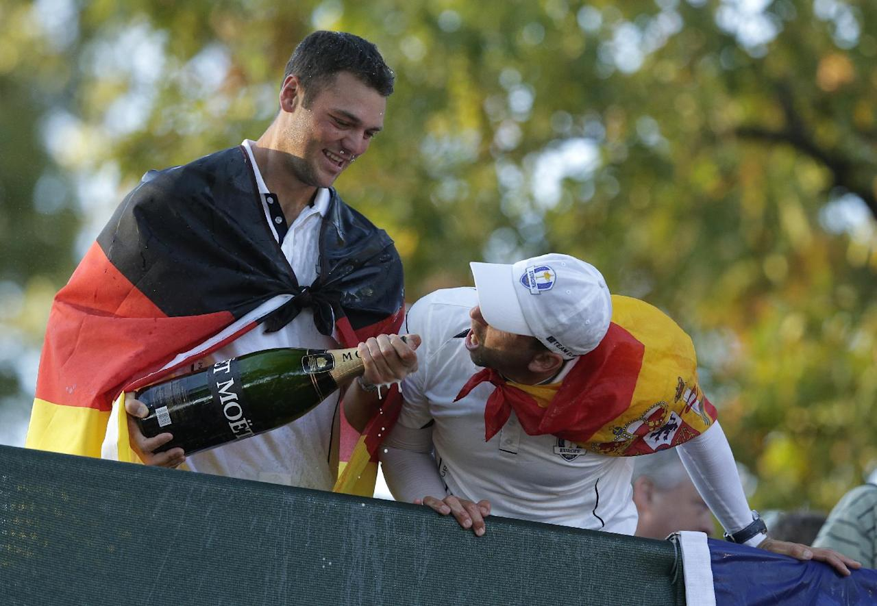 Europe's Martin Kaymer and Sergio Garcia celebrate after winning the Ryder Cup PGA golf tournament Sunday, Sept. 30, 2012, at the Medinah Country Club in Medinah, Ill. (AP Photo/Charlie Riedel)