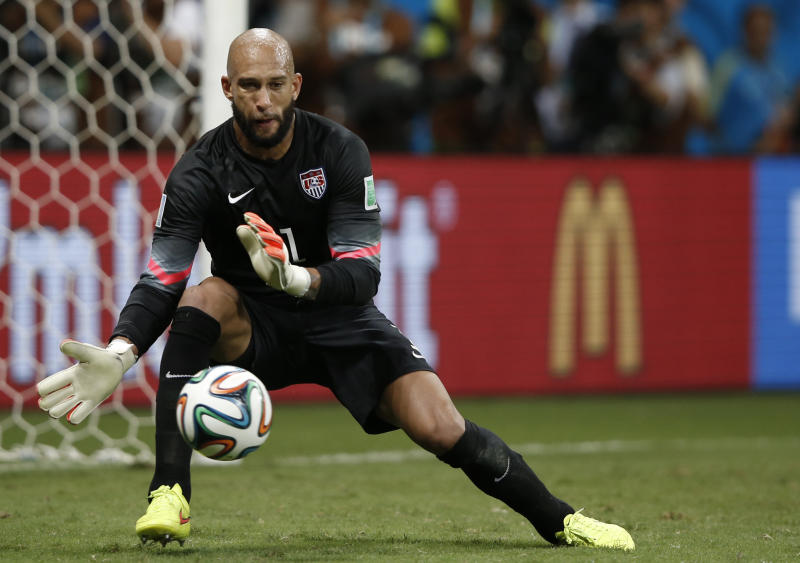 US goalkeeper Tim Howard makes a save during extra-time in the Round of 16 football match between Belgium and USA at The Fonte Nova Arena in Salvador on July 1, 2014, during the 2014 FIFA World Cup