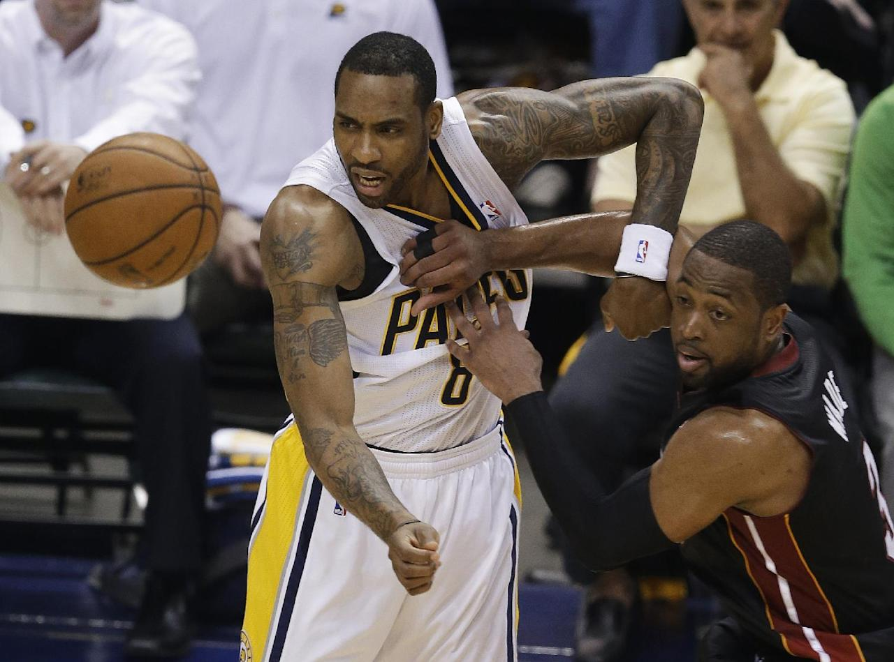 Indiana Pacers' Rasual Butler, left, and Miami Heat's Dwyane Wade watch a loose ball during the first half of Game 5 of the Eastern Conference finals NBA basketball playoff series Wednesday, May 28, 2014, in Indianapolis. (AP Photo/Darron Cummings)