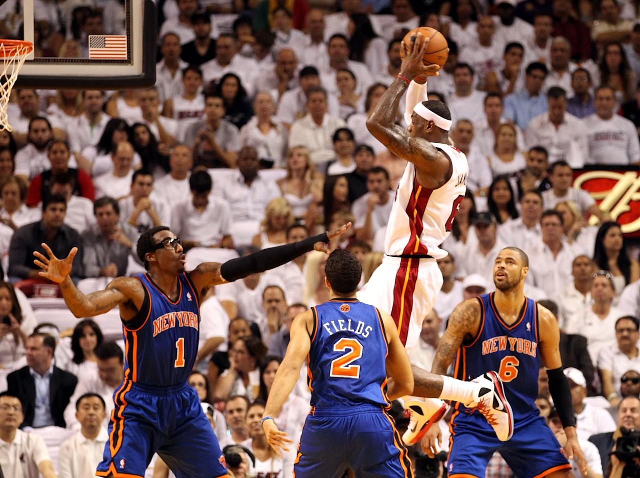 MIAMI, FL - MAY 09:  Forwards Tyson Chandler #6 and Amar'e Stoudemire #1 and guard Landry Fields #2 of the New York Knicks defend Forward LeBron James #6 of the Miami Heat in Game Five of the Eastern Conference Quarterfinals in the 2012 NBA Playoffs  on May 9, 2012 at the American Airines Arena in Miami, Florida. NOTE TO USER: User expressly acknowledges and agrees that, by downloading and or using this photograph, User is consenting to the terms and conditions of the Getty Images License Agreement.  (Photo by Marc Serota/Getty Images)