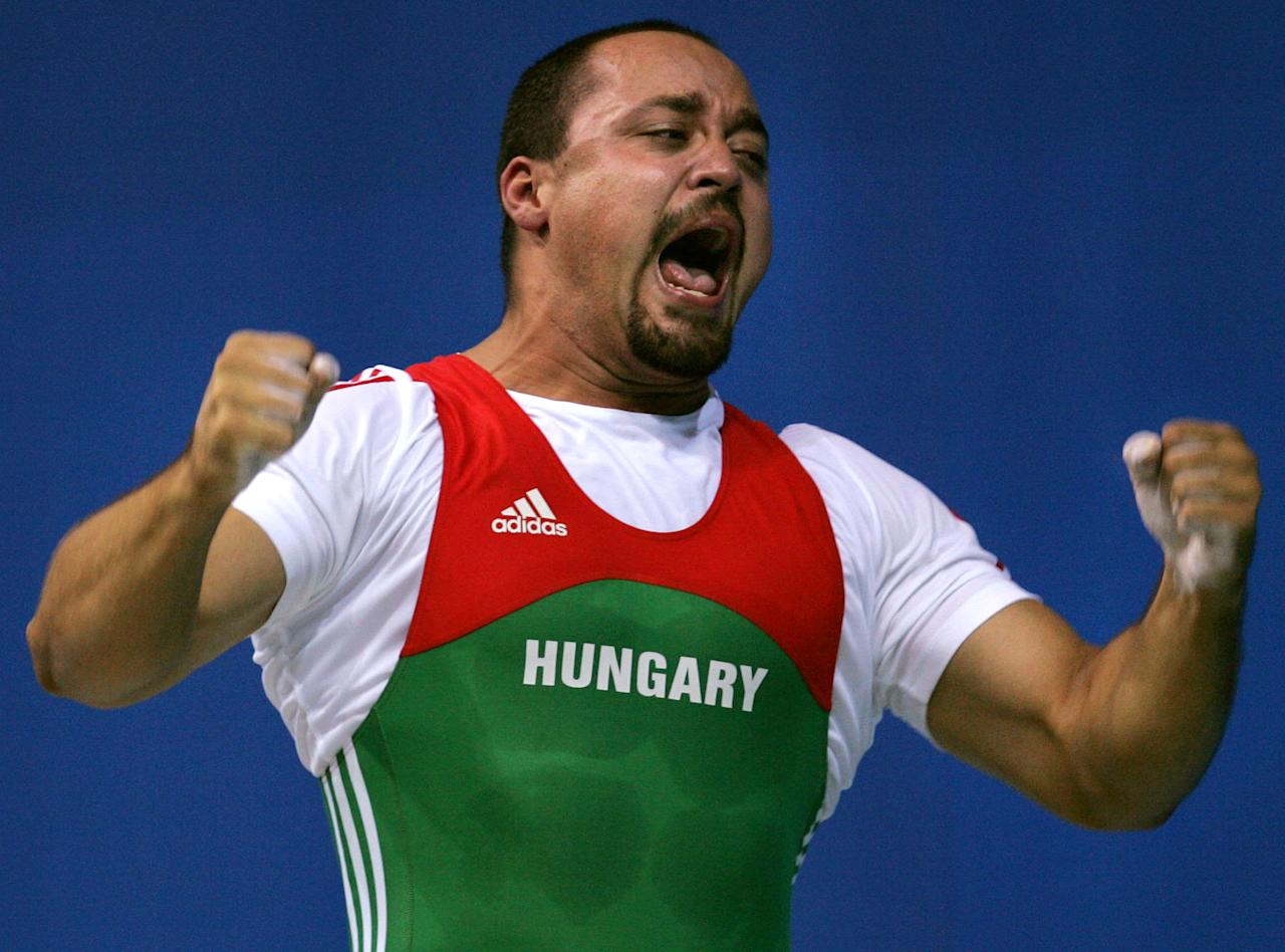 Hungarian weightlifter Ferenc Gyurkovics earned the silver medal in the 105 kg class at the 2004 Athens Games, but he later tested positive for an anabolic steroid. (AP Photo/Charles Krupa)