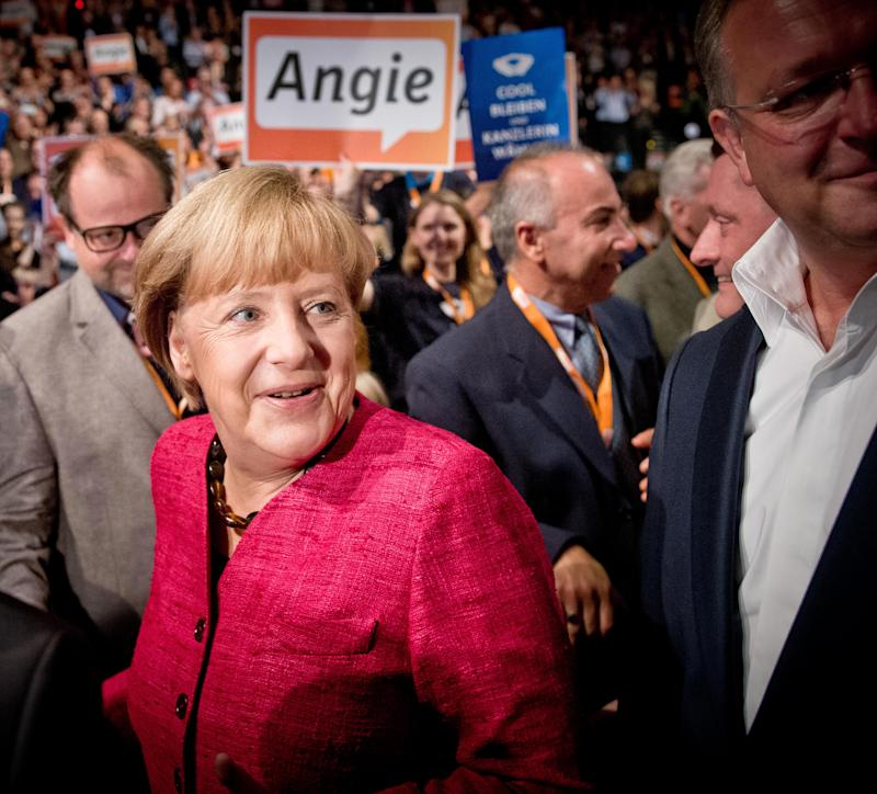 Merkel favored for 3rd term, faces tight outcome
