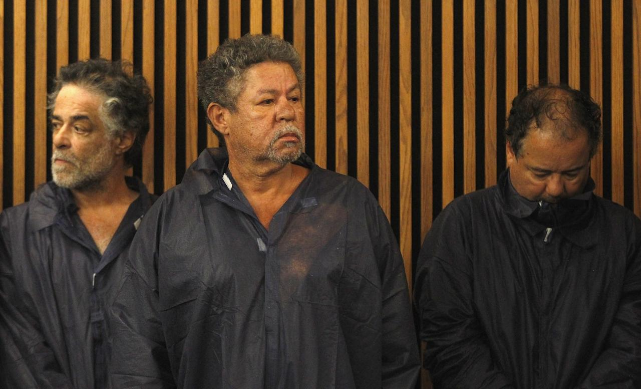 CLEVELAND, OH - MAY 09:  (L-R) Onil Castro, Pedro Castro and Ariel Castro stand in the courtroom during Ariel's arraignment on rape and kidnapping charges May 9, 2013 in Cleveland, Ohio. Ariel Castro is accused of abducting Michelle Knight, Amanda Berry and Gina DeJesus and holding them for about 10 years. (Photo by Matt Sullivan/Getty Images)