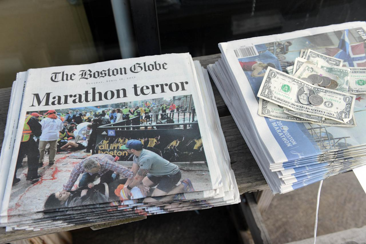 BOSTON - APRIL 16:  Newspapers are on sale at a stand on Newbury Street on April 16, 2013 in Boston, Massachusetts. Security is especially tight in the city of Boston after two explosions went off near the finish of the Marathon, killing three people and injuring at least 141 others. (Photo by Darren McCollester/Getty Images)