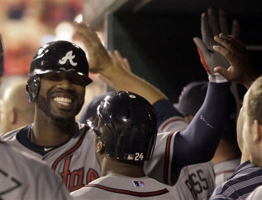 Braves outlast Cardinals 9-7 in 12 innings