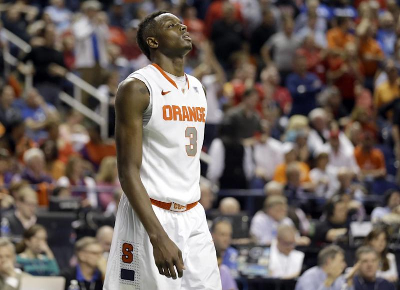 Syracuse's Jerami Grant (3) walks off the court after their loss to North Carolina State in a quarterfinal NCAA college basketball game at the Atlantic Coast Conference tournament in Greensboro, N.C., Friday, March 14, 2014. North Carolina State won 66-63