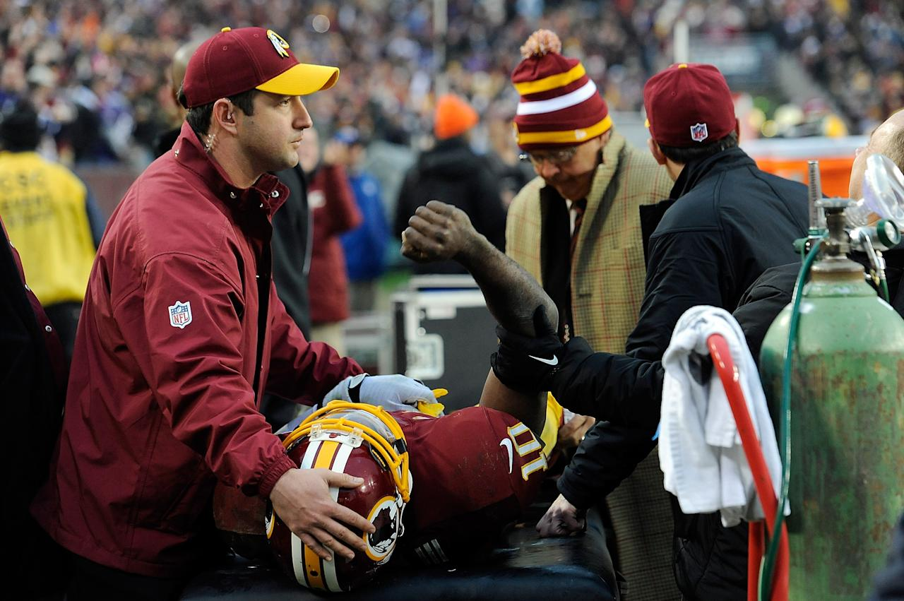 LANDOVER, MD - DECEMBER 09:  Robert Griffin III #10 of the Washington Redskins celebrates after Pierre Garcon #88 scored a touchdown in the fourth quarter during a game against the Baltimore Ravens at FedExField on December 9, 2012 in Landover, Maryland. The Washington Redskins defeated the Baltimore Ravens 31-28 in overtime.  (Photo by Patrick McDermott/Getty Images)