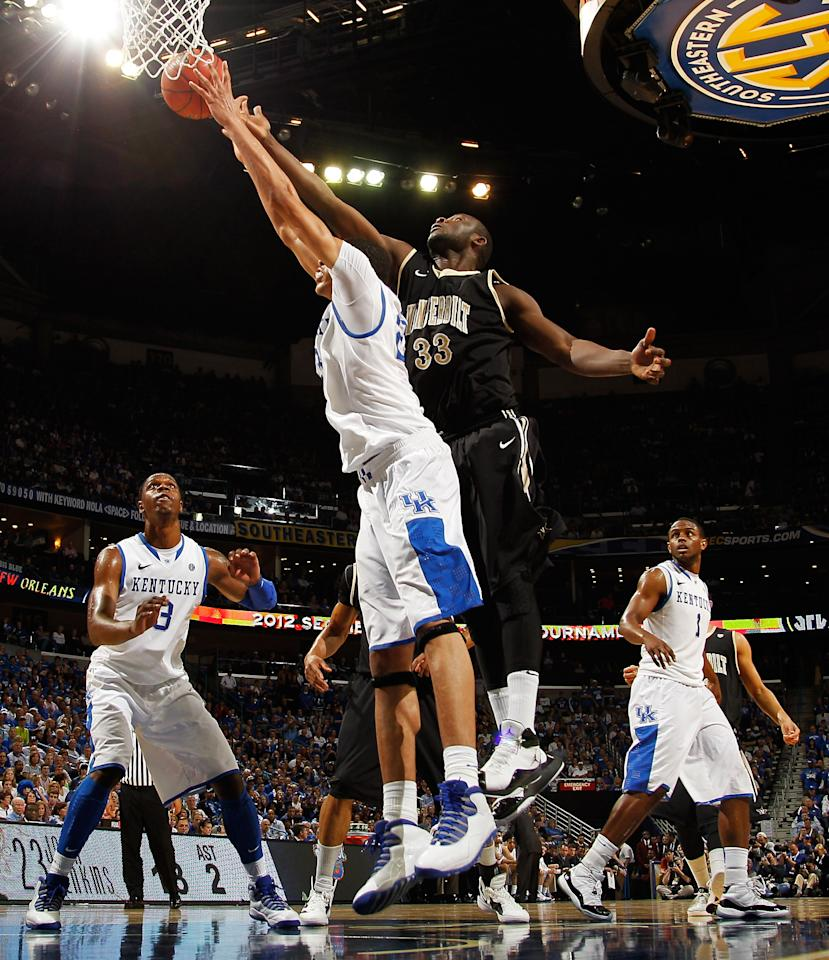 NEW ORLEANS, LA - MARCH 11:  Anthony Davis #23 of the Kentucky Wildcats and Steve Tchiengang #33 of the Vanderbilt Commodores vie for a rebound in the second half during the championship game of the 2012 SEC Men's Basketball Tournament at New Orleans Arena on March 11, 2012 in New Orleans, Louisiana.  (Photo by Chris Graythen/Getty Images)