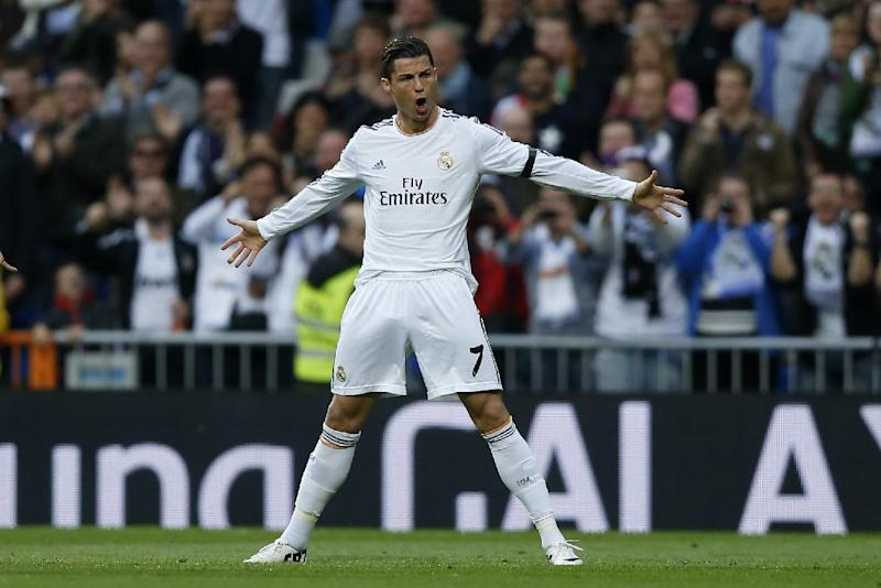 Real's Cristiano Ronaldo celebrates his goal during a Spanish La Liga soccer match between Real Madrid and Osasuna at the Santiago Bernabeu stadium in Madrid, Spain, Saturday, April 26, 2014