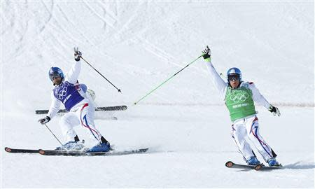 France's Bovolenta and Chapuis cross the finish line during the men's freestyle skiing skicross final at the 2014 Sochi Winter Olympic Games in Rosa Khutor