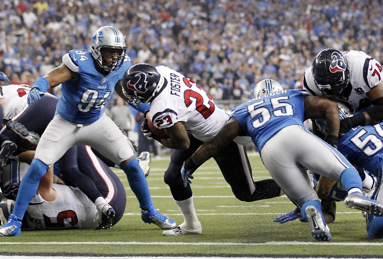 Houston Texans running back Arian Foster breaks away from Detroit Lions defensive end Lawrence Jackson (94) and linebacker Stephen Tulloch (55) for a touchdown during the fourth quarter of an NFL football game at Ford Field in Detroit, Thursday, Nov. 22, 2012. (AP Photo/Rick Osentoski)