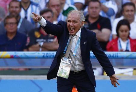 Argentina's coach Sabella gives directions to his players during the 2014 World Cup final between Argentina and Germany at the Maracana stadium in Rio de Janeiro