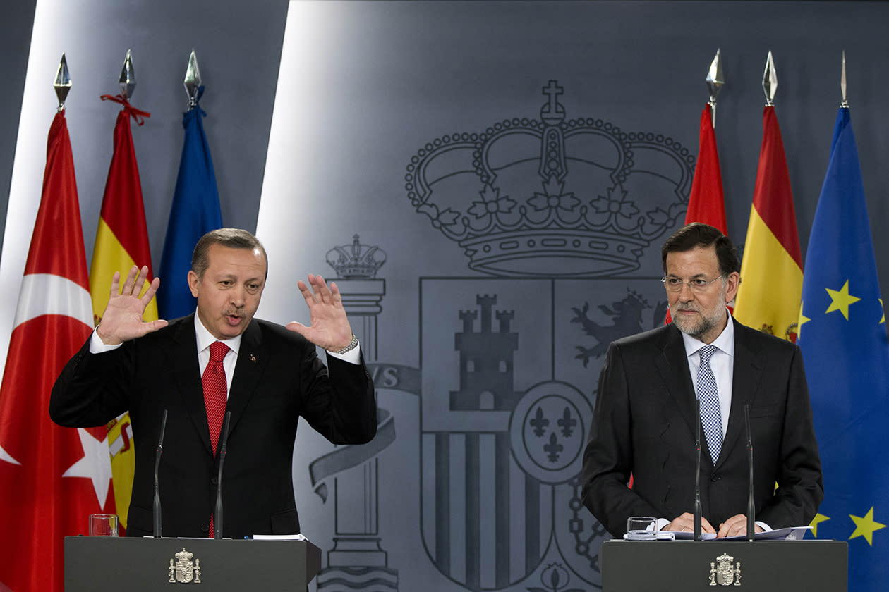 Turkish Prime Minister Recep Tayyip Erdogan, left, gestures during a joint news conference with Spain's Prime Minister Mariano Rajoy after a meeting at the Moncloa Palace, in Madrid.