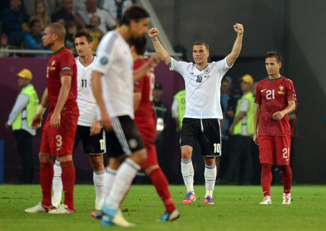 German forward Lukas Podolski (2ndR) celebrates at the end of  the Euro 2012 championships football match Germany vs Portugal  on June 9, 2012 at the Arena Lviv.  Germany won 1-0. AFP PHOTO / JEFF PACHOUDJEFF PACHOUD/AFP/GettyImages
