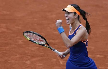 Ana Ivanovic of Serbia reacts after winning her women's singles match against Elina Svitolina of Ukraine at the French Open tennis tournament at the Roland Garros stadium in Paris