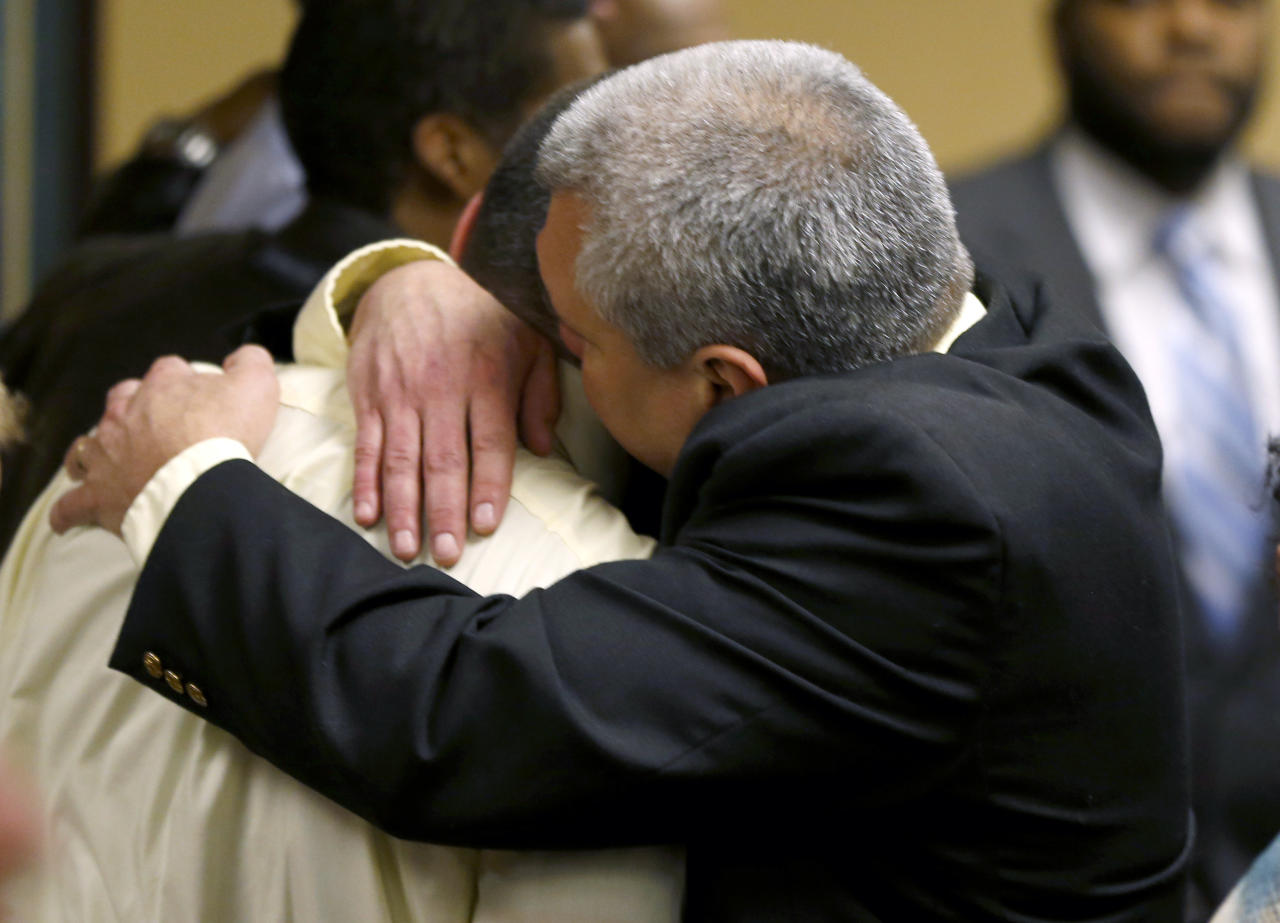 Trent Mays, 17, left, gets a hug from his father, Brian Mays, after Trent and co-defendant Ma'Lik Richmond, 16, were found delinquent on rape and other charges after their trial in juvenile court in Steubenville, Ohio, Sunday, March 17, 2013. Mays and Richmond were accused of raping a 16-year-old West Virginia girl in August 2012. (AP Photo/Keith Srakocic, Pool)