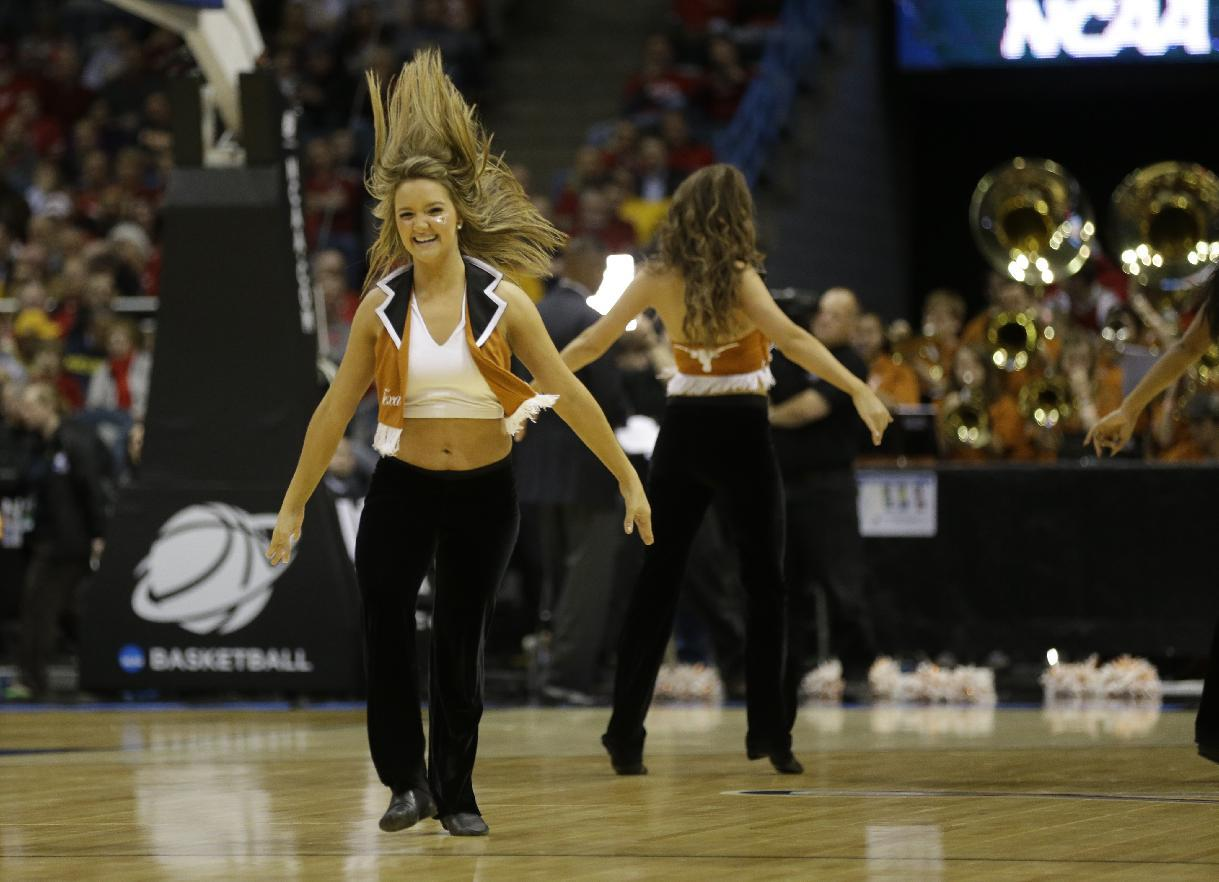 Texas cheerleaders perform during the first half of a third-round game between the Michigan and the Texas of the NCAA college basketball tournament Saturday, March 22, 2014, in Milwaukee. (AP Photo/Jeffrey Phelps)
