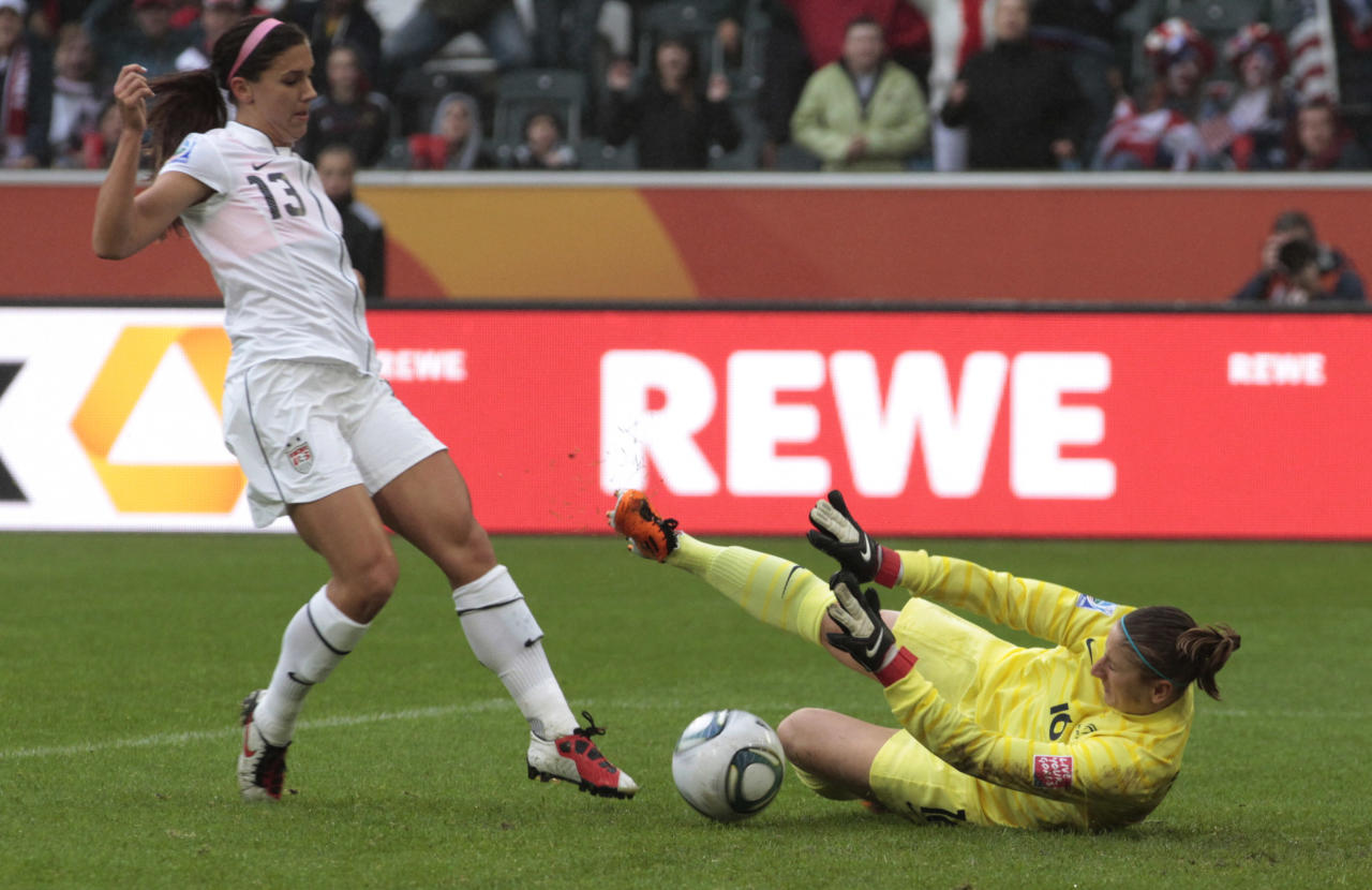 United States' Alex Morgan fails to score past France goalkeeper Berangere Sapowicz during the semifinal match between France and the United States at the Women's Soccer World Cup in Moenchengladbach, Germany, Wednesday, July 13, 2011. (AP Photo/Yves Logghe)
