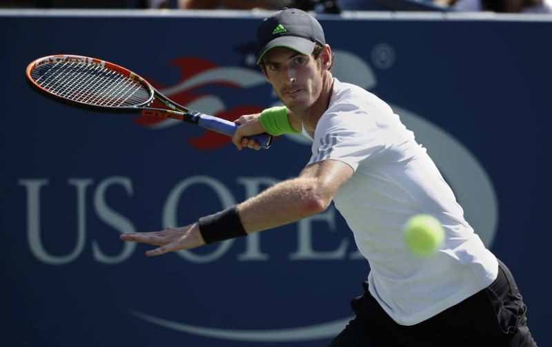 Andy Murray, of the United Kingdom, returns a shot against Robin Haase, of the Netherlands, during the opening round of the 2014 U.S. Open tennis tournament, Monday, Aug. 25, 2014, in New York