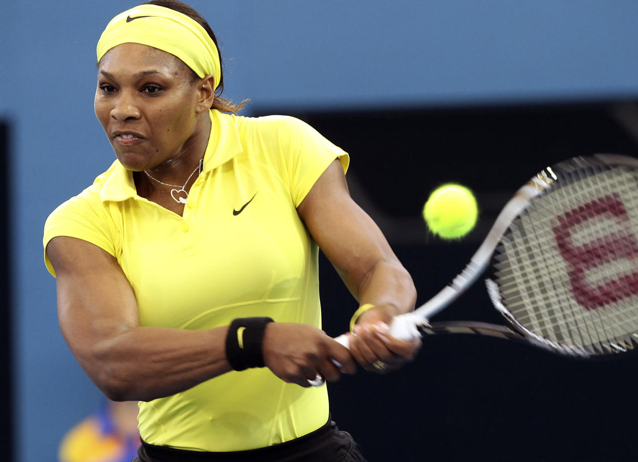 Serena Williams of the United States plays a shot in her match against South Africa's Chanelle Scheepers during the Brisbane International tennis tournament in Brisbane, Australia, Monday, Jan 2, 2012. (AP Photo/Tertius Pickard)