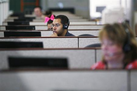Specialists help callers with health insurance, at a call center in Providence, Rhode Island