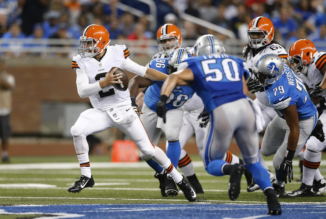 Cleveland Browns quarterback Johnny Manziel (2) scrambles from the Detroit Lions rush in the second half of a preseason NFL football game at Ford Field in Detroit, Saturday, Aug. 9, 2014. (AP Photo/Rick Osentoski)