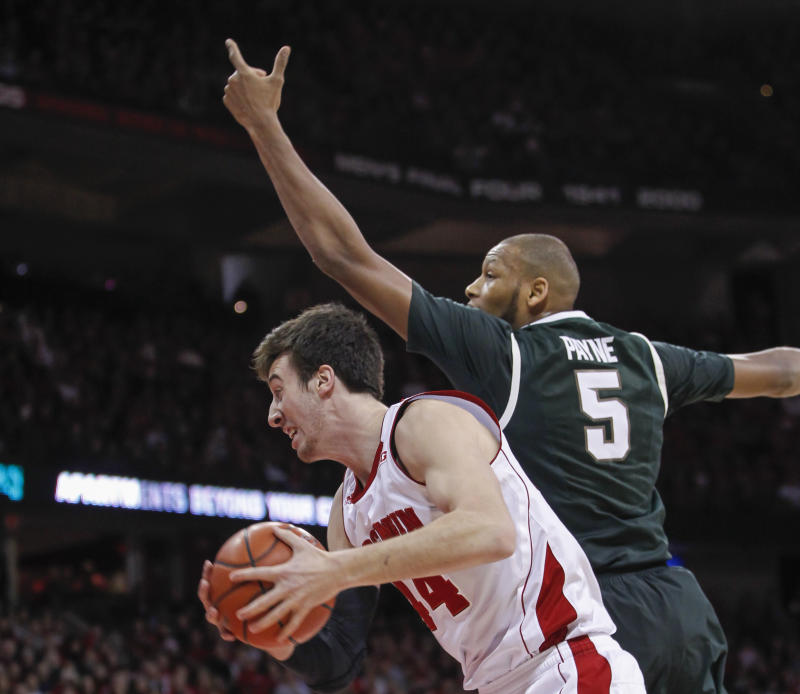 Jackson lifts Badgers over No. 9 Spartans 60-58