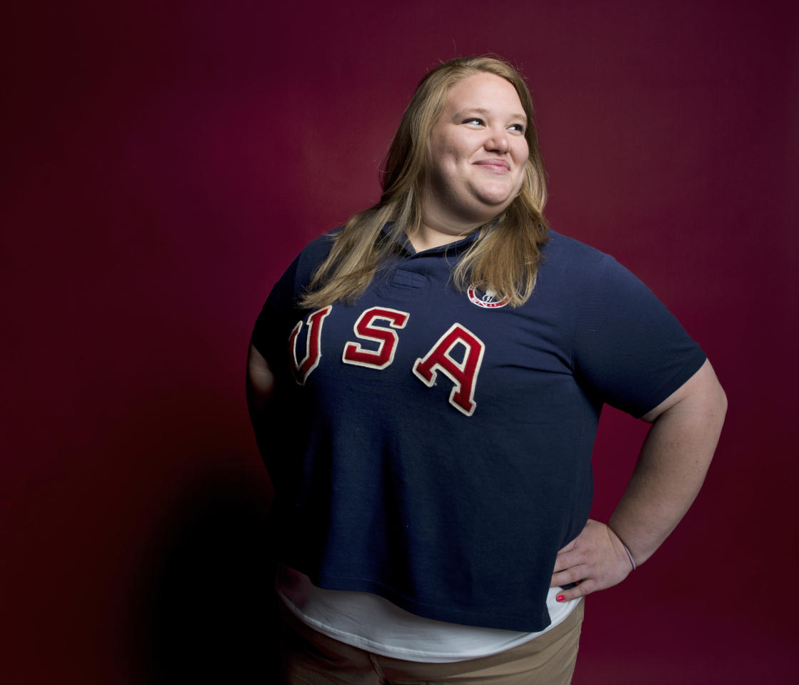In this May 13, 2012, photo, weightlifter Holley Mangold poses for a portrait at the Team USA Media Summit in Dallas. Mangold first made news playing offensive line as the only girl on her high school football team in Ohio. But she switched sports a few years ago and now the 5-foot-8 sister of New York Jets Pro Bowl center Nick Mangold will compete as a superheavyweight in weightlifting at the London Olympics. (AP Photo/Victoria Will)