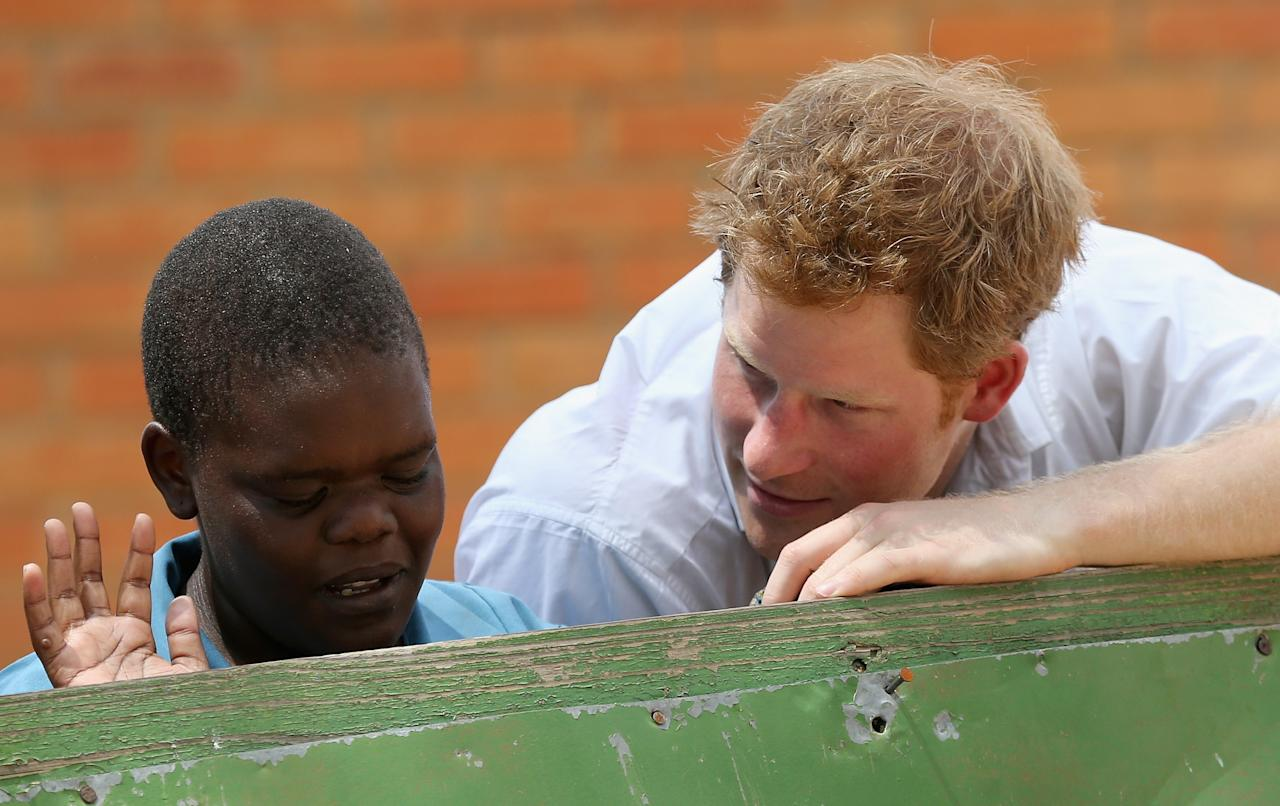 MASERU, LESOTHO - FEBRUARY 27:  Prince Harry meets partially sighted children at St Bernadette's Centre for the blind a project supported by his charity Sentebale on February 27, 2013 in Maseru, Lesotho. Sentebale is a charity founded by Prince Harry and Prince Seeiso of Lesotho. It helps the most vulnerable children in Lesotho get the support they need to lead healthy and productive lives. Sentebale works with local grassroots organisations to help these children, the victims of extreme poverty and Lesotho's HIV/AIDS epidemic. Cathy Ferrier was appointed as Sentebale's Chief Executive in March 2012 and is spearheading a fundraising initiative to build the Mamohato Centre which will provide psychosocial support for children and young people infected with HIV. Prince Harry is due to pay a visit to Lesotho this week to catch up on his charity's progress and meet key children who will be supported by the charity.  (Photo by Chris Jackson/Getty Images)
