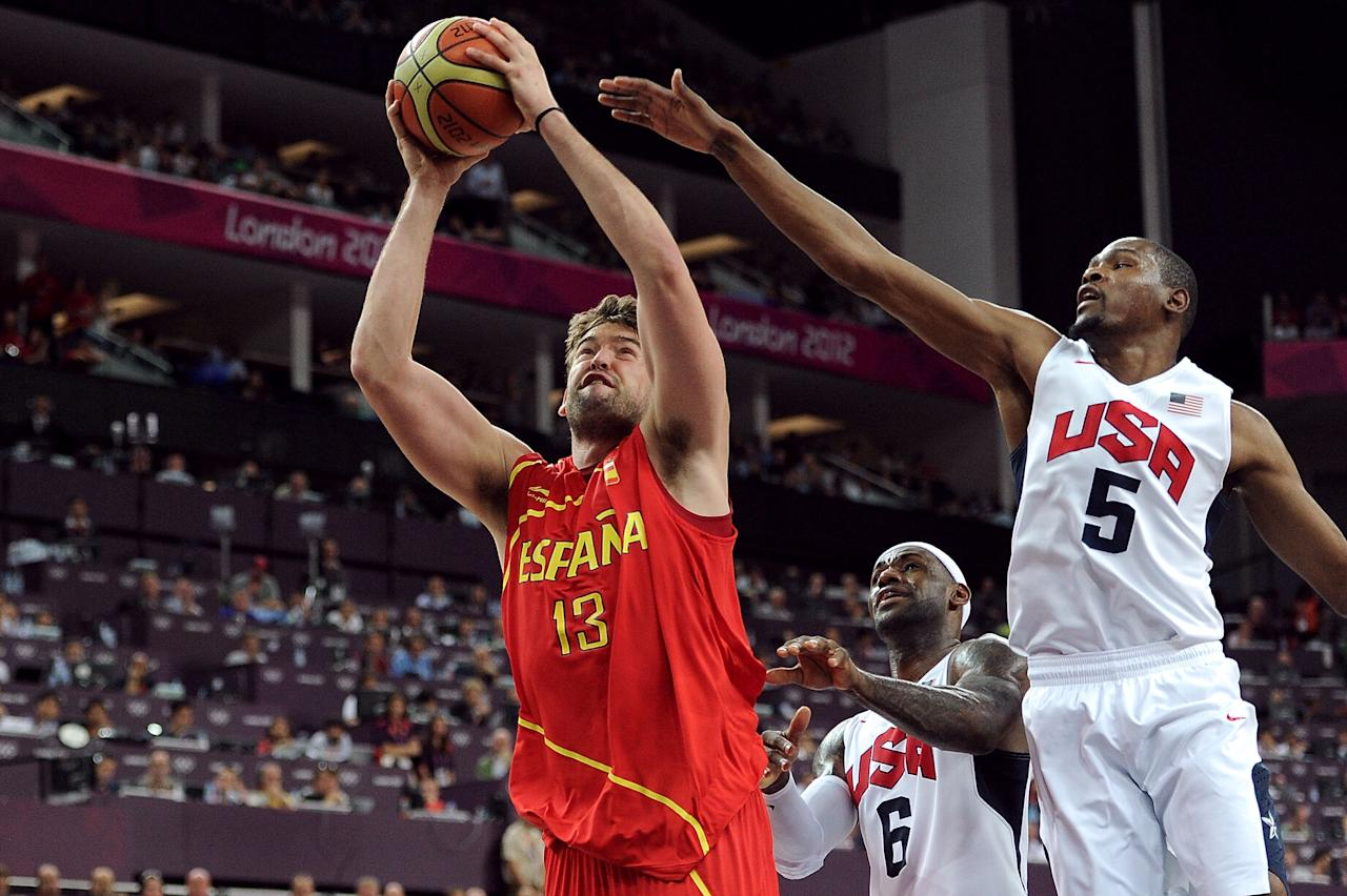 LONDON, ENGLAND - AUGUST 12:  Marc Gasol #13 of Spain drives past Kevin Durant #5 of the United States to score during the Men's Basketball gold medal game between the United States and Spain on Day 16 of the London 2012 Olympics Games at North Greenwich Arena on August 12, 2012 in London, England.  (Photo by Harry How/Getty Images)