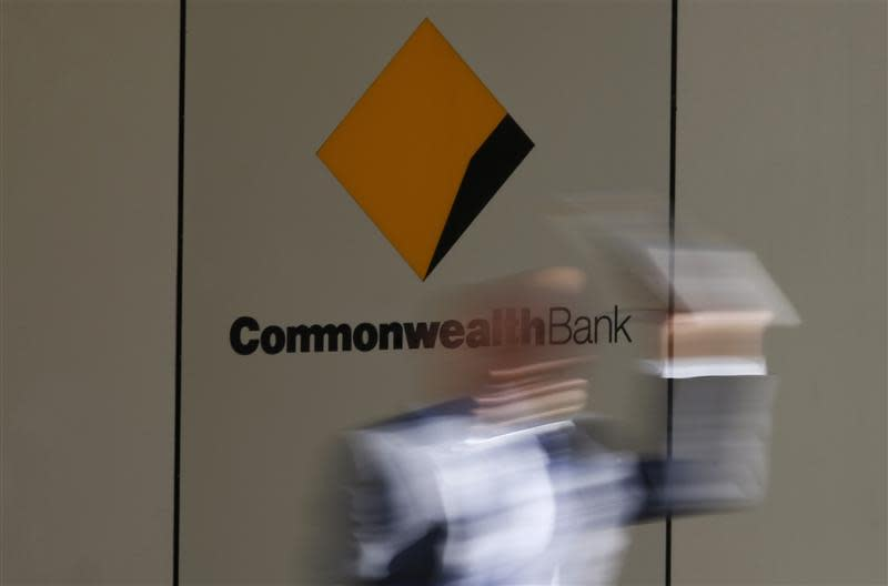 File photo of a man leaving the Commonwealth Bank of Australia building in central Sydney