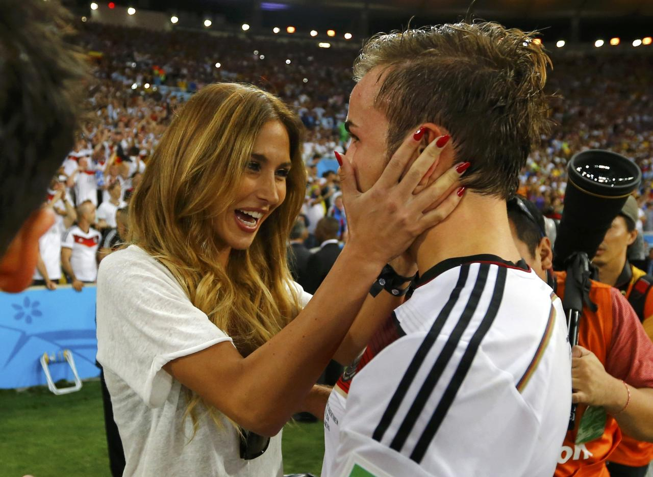 Germany's Mario Goetze hugs his girlfriend Ann-Kathrin Brommel after extra time in the 2014 World Cup final between Germany and Argentina at the Maracana stadium in Rio de Janeiro July 13, 2014. REUTERS/Darren Staples (BRAZIL - Tags: ENTERTAINMENT SOCCER SPORT WORLD CUP)