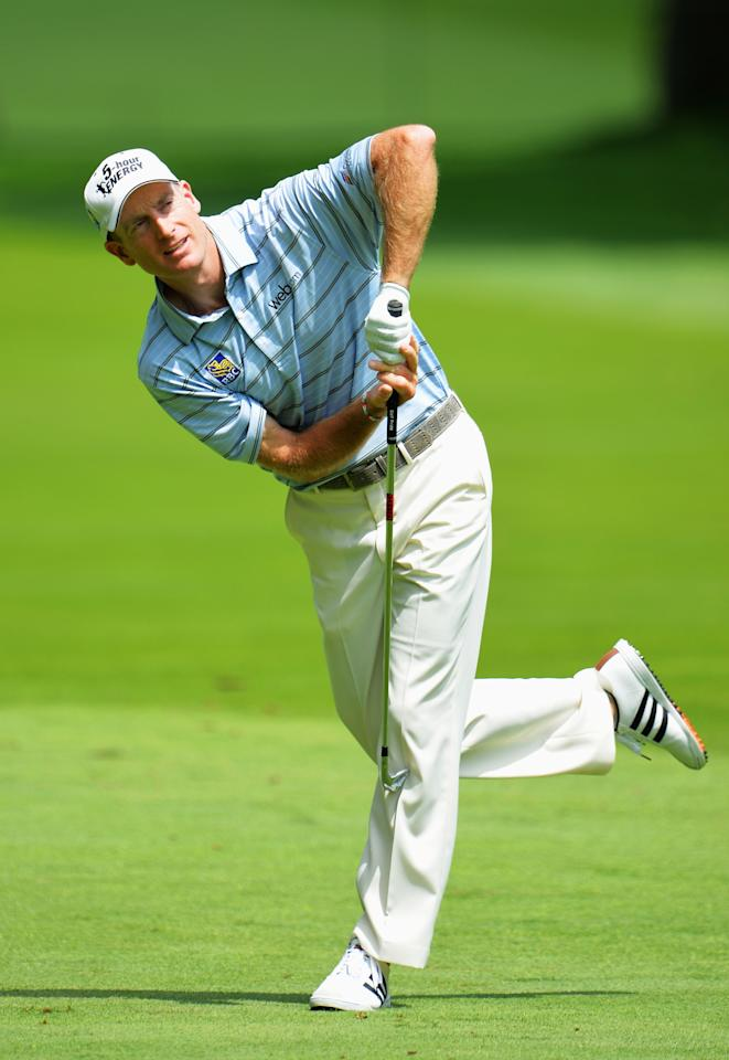 ROCHESTER, NY - AUGUST 08: Jim Furyk of the United States reacts to his approach shot on the eighth hole during the first round of the 95th PGA Championship on August 8, 2013 in Rochester, New York. (Photo by Stuart Franklin/Getty Images)