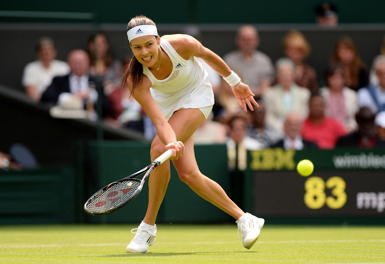 LONDON, ENGLAND - JUNE 26: Ana Ivanovic of Serbia plays a forehand during her Ladies' Singles second round match against Eugenie Bouchard of Canada on day three of the Wimbledon Lawn Tennis Championships at the All England Lawn Tennis and Croquet Club on June 26, 2013 in London, England. (Photo by Mike Hewitt/Getty Images)