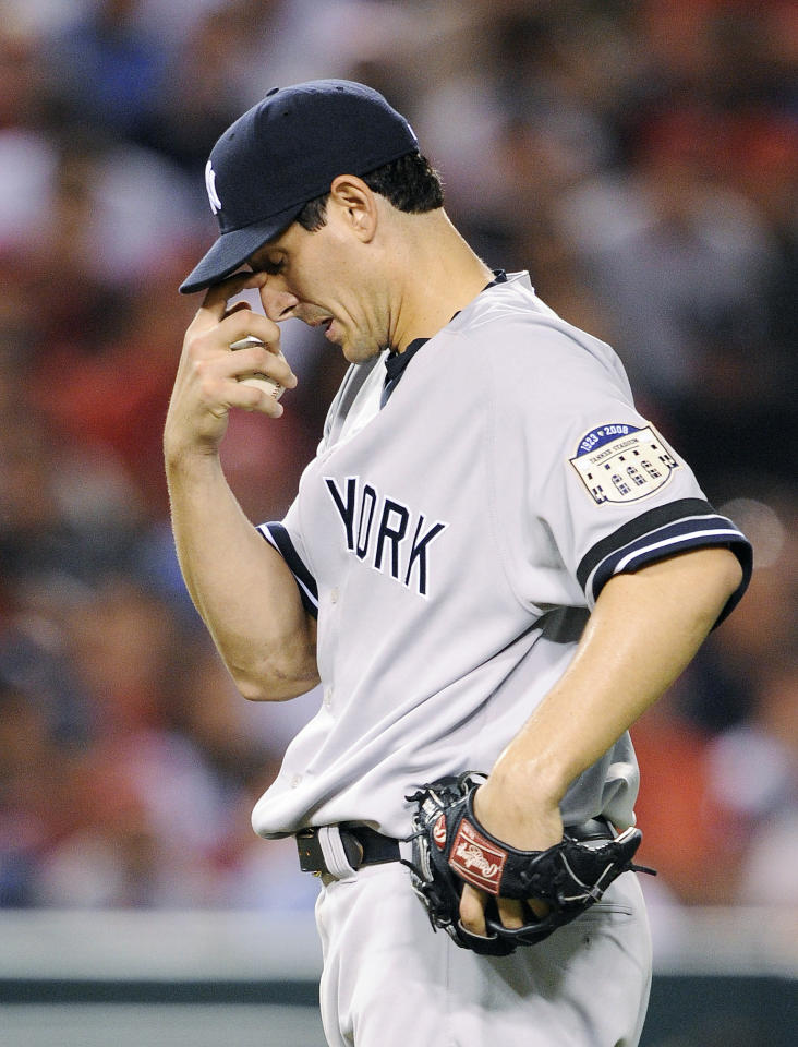 In this Sept. 8, 2008 file photo, New York Yankees pitcher Carl Pavano reacts after a balk to allow Los Angeles Angels' Mike Napoli to advance to second base during the fifth inning of a baseball game in Anaheim, Calif. The Yankees haven't been mathematically eliminated since Sept. 27, 1993, when Bill Clinton was a first-year president and gasoline averaged about $1.13 per gallon.  (AP Photo/Kevork Djansezian, File)