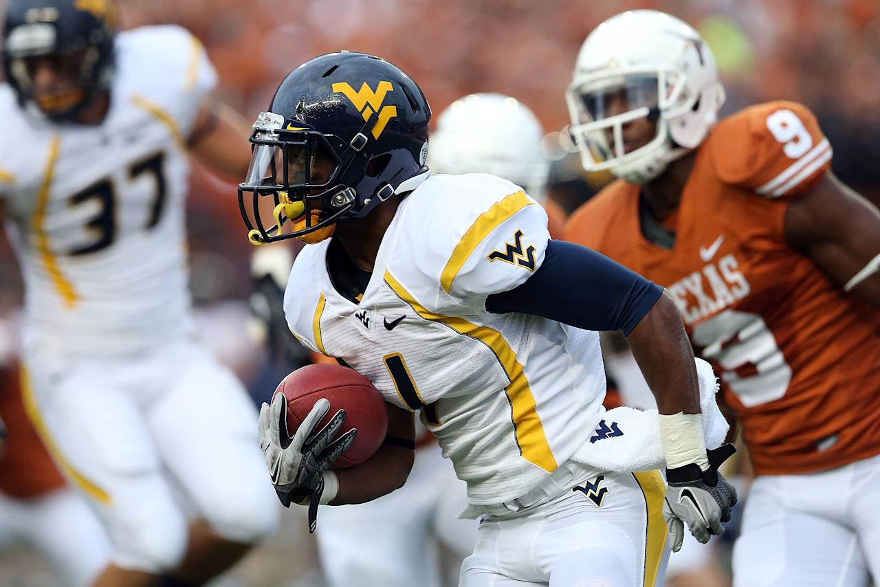 AUSTIN, TX - OCTOBER 06:  Tavon Austin #1 of the West Virginia Mountaineers returns a kickoff against the Texas Longhorns at Darrell K Royal-Texas Memorial Stadium on October 6, 2012 in Austin, Texas.  (Photo by Ronald Martinez/Getty Images)