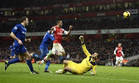 Arsenal's Walcott shoots and scores past Cardiff City goalkeeper Marshall during their English Premier League soccer match in London
