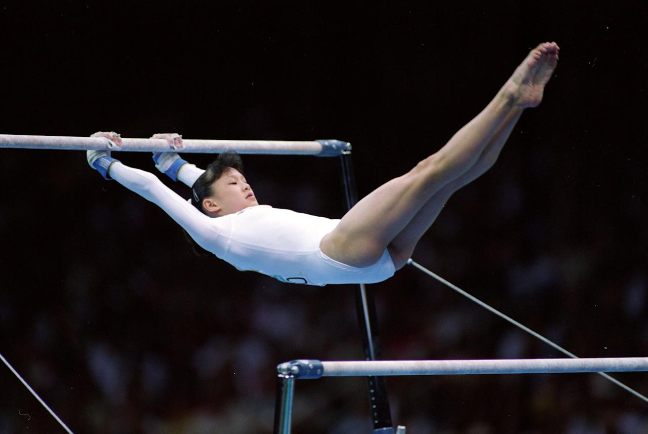 28 Jul 1996: Amy Chow of the USA swings on the parellel bars during her routine at the Georgia Dome in the 1996 Olympic Games in Atlanta, Georgia. Mandatory Credit: Pascal Rondeau  /Allsport
