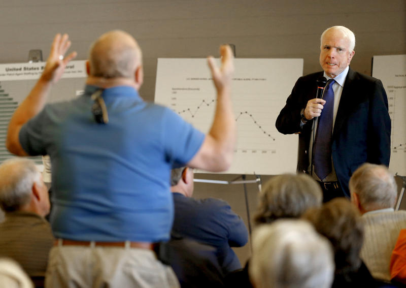 McCain defends immigration plan to angry residents