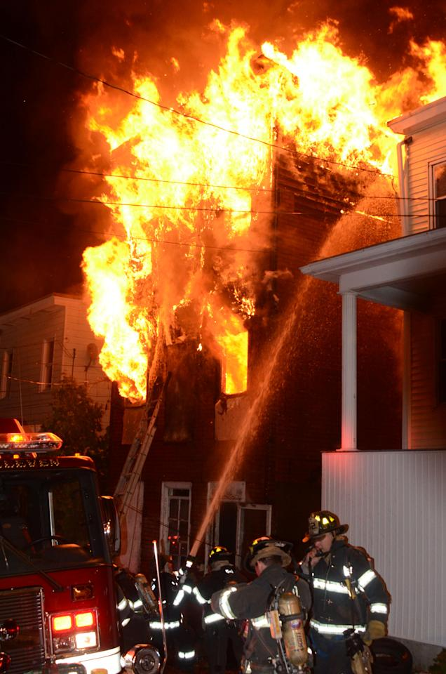 Firefighters battle an early-morning house fire that killed four children and two adults in Pottsville, Pa., Monday, May 13, 2013. The blaze broke out around 11:55 p.m. Sunday at the single-family home, which sits on a steep hillside not far from the D.G. Yuengling & Son brewery. (AP Photo/JC Kriesher)