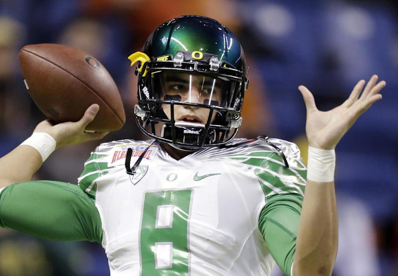 Marcus Mariota should be a Heisman Trophy candidate this season. (AP)
