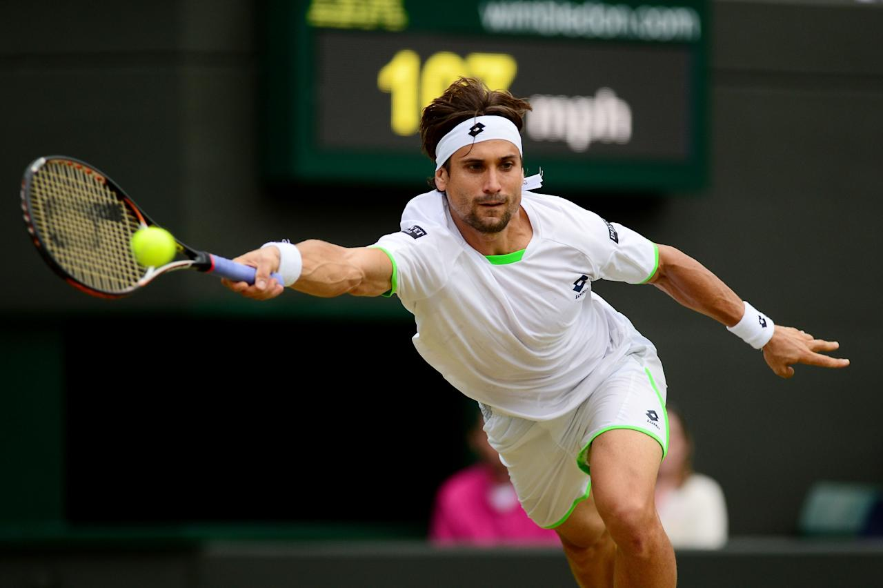 LONDON, ENGLAND - JUNE 29: David Ferrer of Spain plays a forehand during the Gentlemen's Singles third round match against Alexandr Dolgopolov of Ukraine on day six of the Wimbledon Lawn Tennis Championships at the All England Lawn Tennis and Croquet Club on June 29, 2013 in London, England. (Photo by Mike Hewitt/Getty Images)