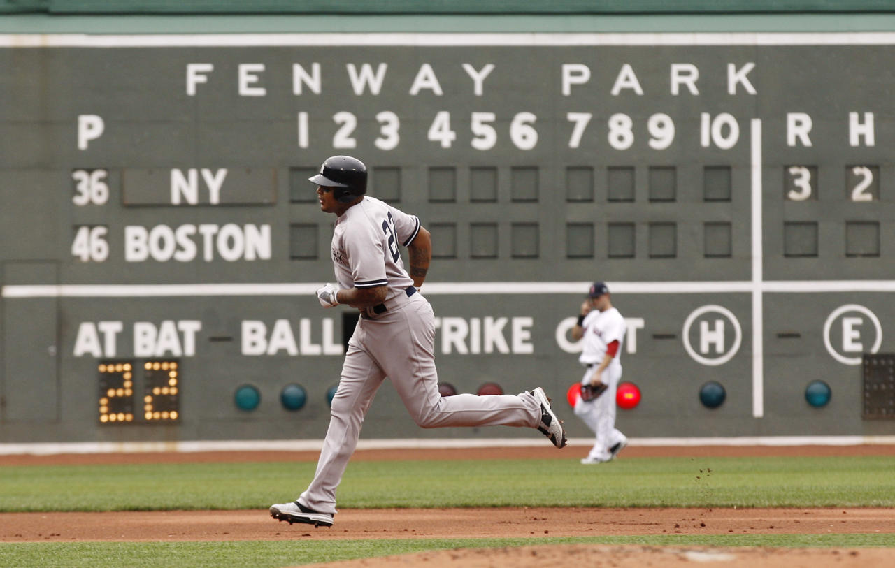 BOSTON, MA - JULY 7: Andruw Jones #22 of the New York Yankees rounds the bases after hitting a home run during the first inning of Game One of a doubleheader against the Boston Red Sox at Fenway Park on July 7, 2012 in Boston, Massachusetts. (Photo by Winslow Townson/Getty Images)