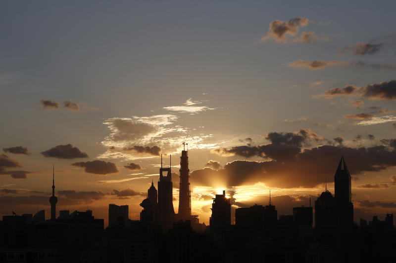 The sunrise rises over the skyline of Lujiazui financial district of Pudong in Shanghai