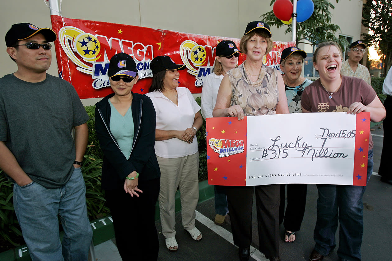 <b>$315 million</b><br><br>The seven winners of the $315 million Mega Millions jackpot lottery talk to reporters during a news conference at the Califorina Lottery headquarter in Santa Fe Springs, Calif., Friday, Nov. 18, 2005. The lucky seven from left to right are Bob Guerzon, Mariza Cuya, Kathy Jones, Brenda Heller, Jennifer Habib, Joyce Onori and Kate Lynn Juergens.