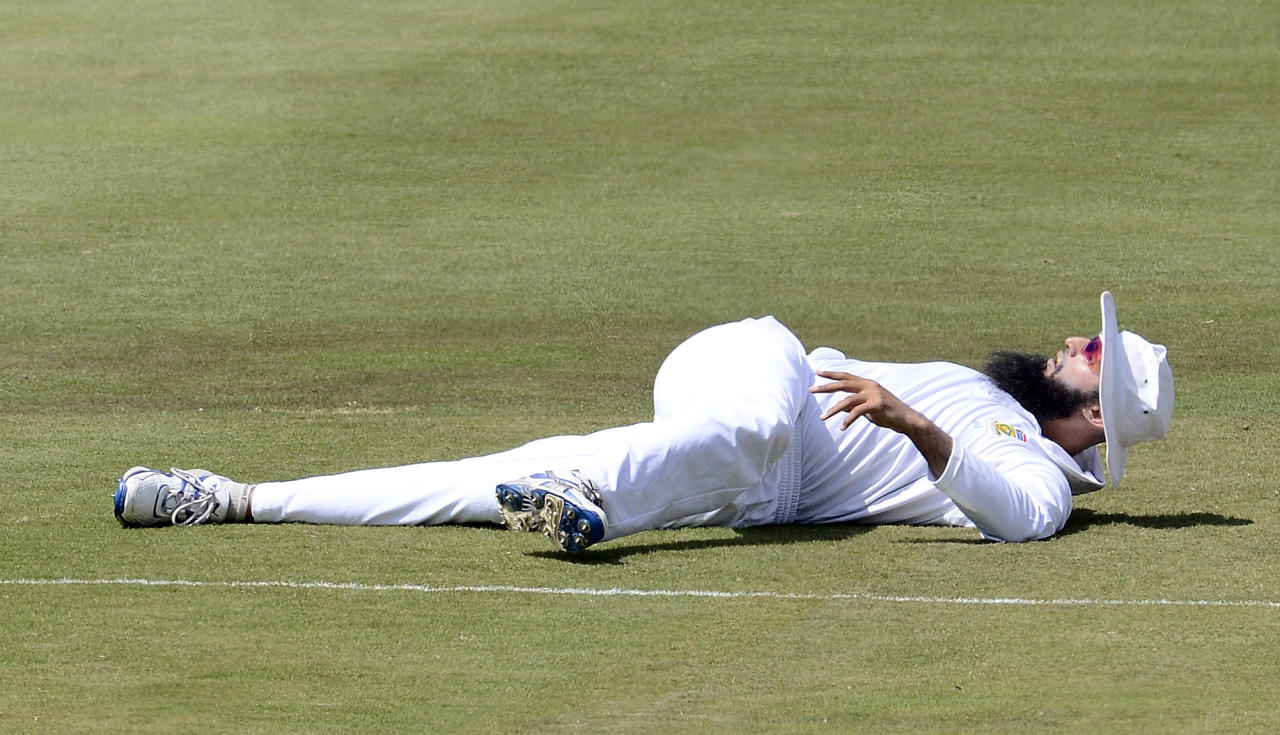 South African bowler Hashim Amla streches ahead the third day of the third Test match between South Africa and Pakistan on February 24, 2013 at Super Sport Park in Centurion. AFP PHOTO / STEPHANE DE SAKUTIN        (Photo credit should read STEPHANE DE SAKUTIN/AFP/Getty Images)