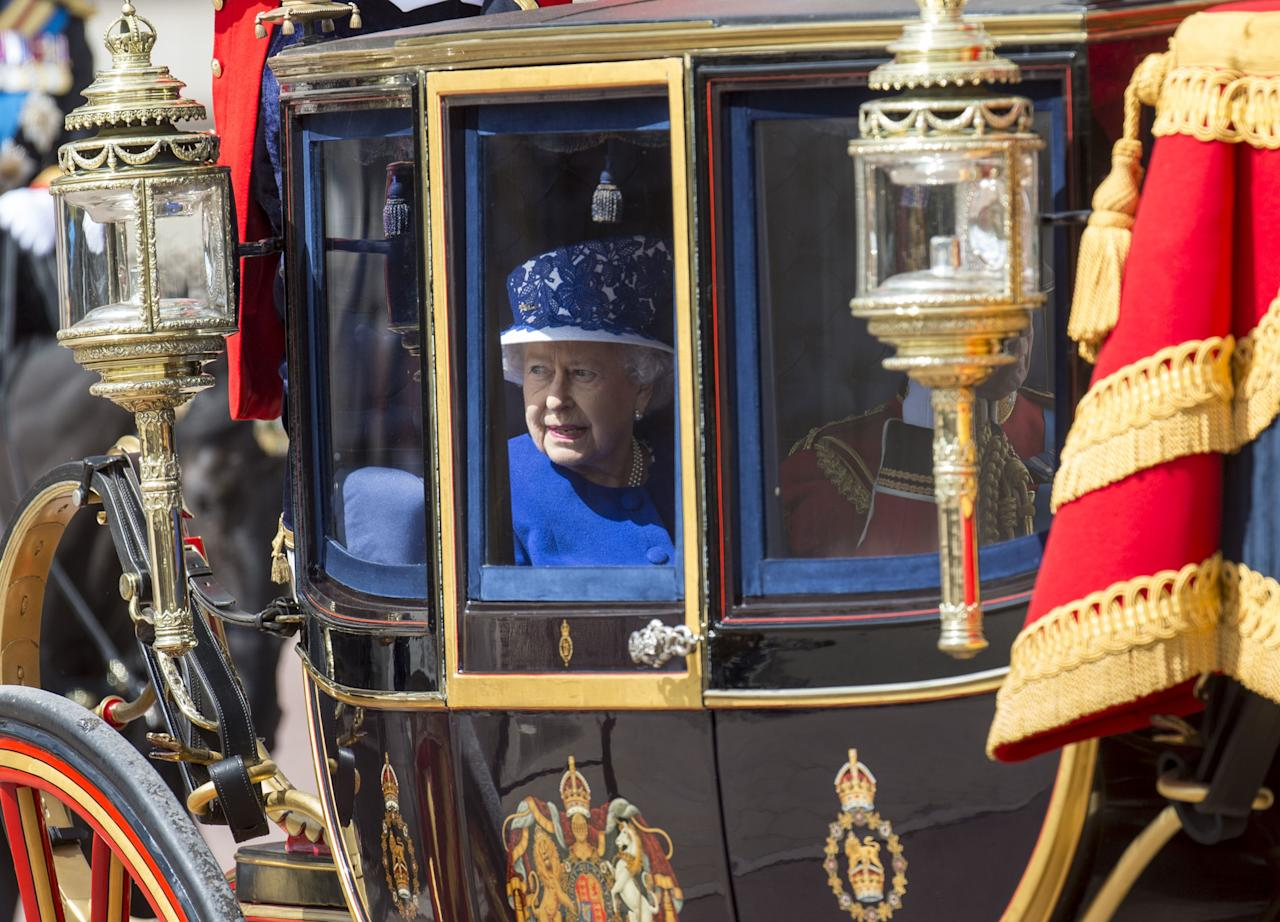 LONDON, ENGLAND - JUNE 15:  Queen Elizabeth II during the annual Trooping The Colour ceremony at Horse Guards Parade on June 15, 2013 in London, England.  Today's ceremony which marks the Queens official birthday will not be attended by Prince Philip the Duke of Edinburgh as he recuperates from abdominal surgery and will also be The Duchess of Cambridge's last public engagement before her baby is due to be born next month.  (Photo by Mark Cuthbert/UK Press via Getty Images)