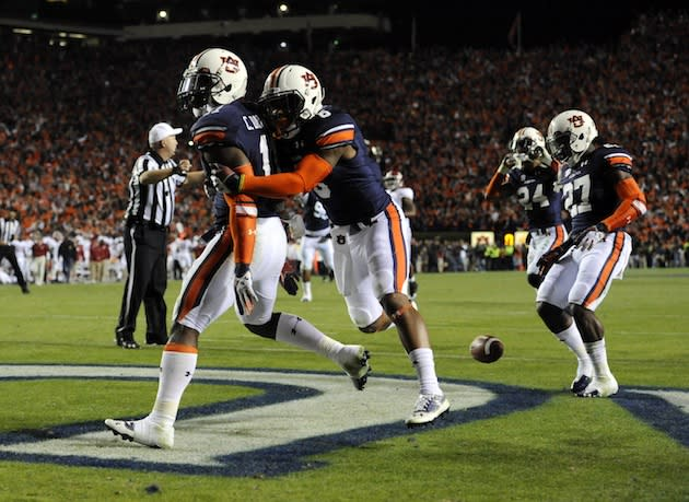 Auburn defeats Alabama, clinches SEC title game berth on ...