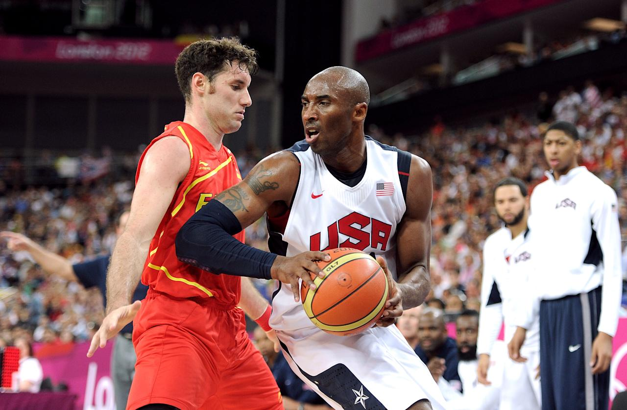 LONDON, ENGLAND - AUGUST 12:  Kobe Bryant #10 of the United States takes the ball up against Rudy Fernandez #5 of Spain during the Men's Basketball gold medal game between the United States and Spain on Day 16 of the London 2012 Olympics Games at North Greenwich Arena on August 12, 2012 in London, England.  (Photo by Harry How/Getty Images)